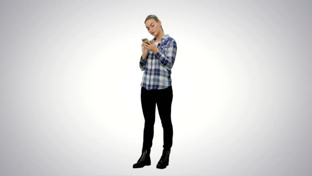 Tired-working-young-woman-reading-messages-on-the-phone-on-white-background
