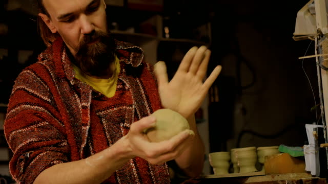 Professional-male-potter-preparing-clay-for-work