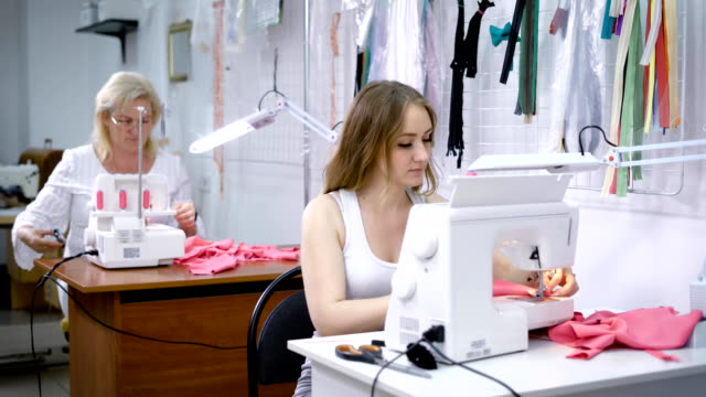 Two-small-business-founders-at-their-workplace-in-a-tailor-shop