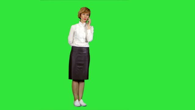 Smiling-woman-having-a-phone-call-on-a-Green-Screen-Chroma-Key