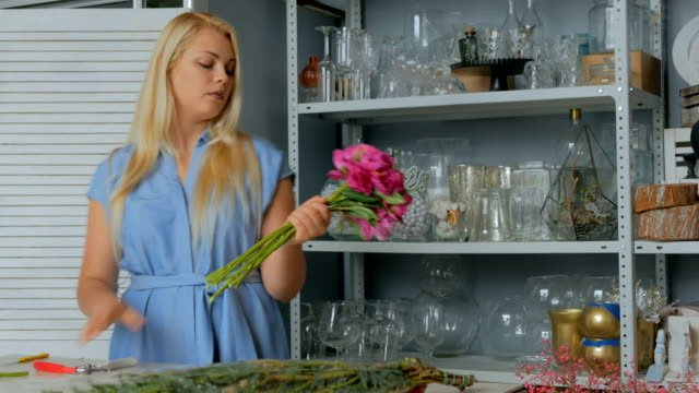 Professional-florist-working-at-flower-store