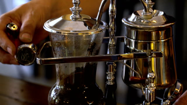 Barista-brewing-coffee-method-pour-over-drip-coffee-Barista-brewing-coffee-method-pour-over-drip-coffee-