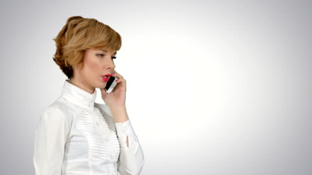 Happy-businesswoman-speaking-at-the-phone-on-white-background