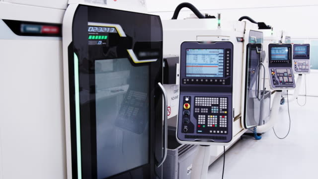 Interior-Of-Modern-Engineering-Workshop-With-Hi-Tech-CNC-Machinery-In-Operation