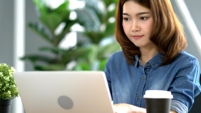 beautiful-asian-smart-woman-work-with-energy-and-happiness-joyful-in-modern-office-background