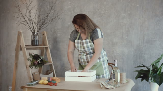 Woman-arranging-food-ingredients-on-the-table