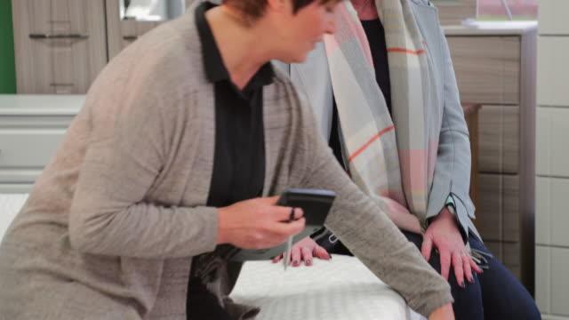 Mature-Woman-Buying-New-Mattress