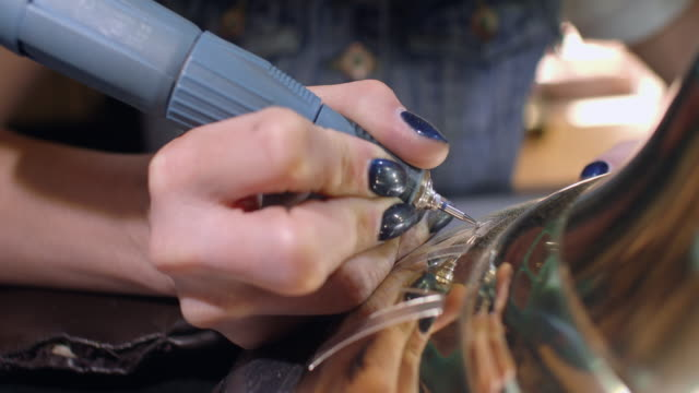 The-engraver-applies-the-inscription-on-the-bell-with-the-drill-