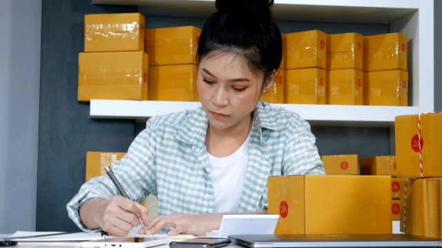 young-woman-entrepreneur-calculating-financial-at-home-office-online-market-packing-box-delivery-startup-small-business-owner
