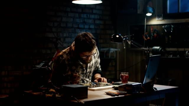 Man-repairing-a-mother-board