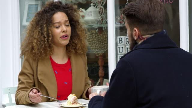 Couple-Talking-Outside-Cafe-Enjoying-Coffee-On-R3D