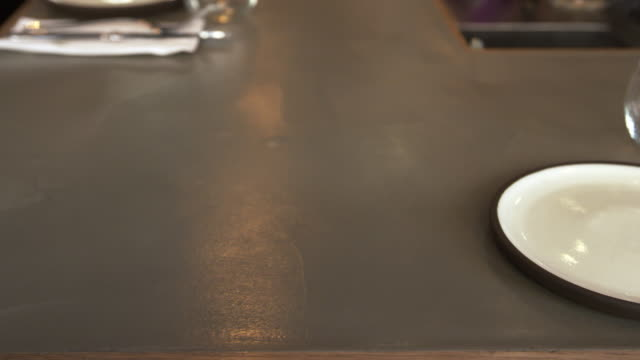 Empty-place-setting-at-a-restaurant-bar-camera-slider-shot