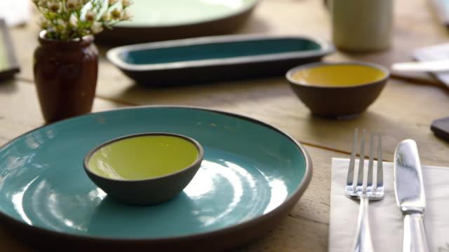 Handmade-earthenware-on-restaurant-table-camera-slider-shot