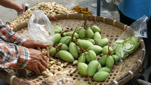 Selling-boiled-peanuts-and-mangoes-street-food-Thailand