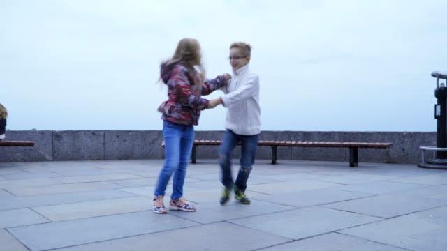 Kids-dancing-fast-dance-outdoors