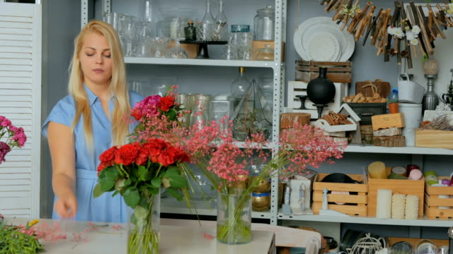 Professional-florist-making-beautiful-bouquet-at-flower-store