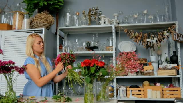 4-shots-Professional-florist-making-floral-wedding-composition-at-flower-shop