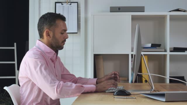 Handsome-entrepreneur-using-internet-for-job-