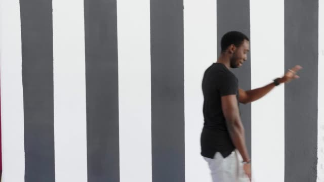 young-hipster-handsome-afroamerican-black-man-dancing-hip-hop-style-