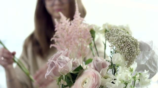 Young-Florist-Assembles-a-Bouquet