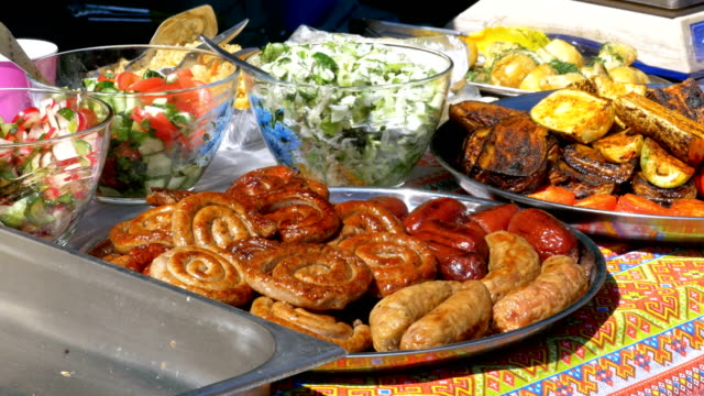 Top-view-on-Various-sausages-vegetables-Bulgarian-pepper-and-other-food-cooked-on-the-grill