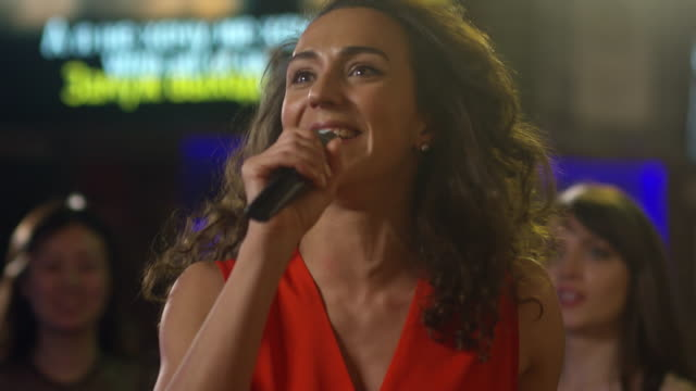 Curly-Haired-Woman-Enjoying-Singing
