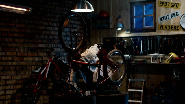 Man-working-in-a-bicycle-repair-shop