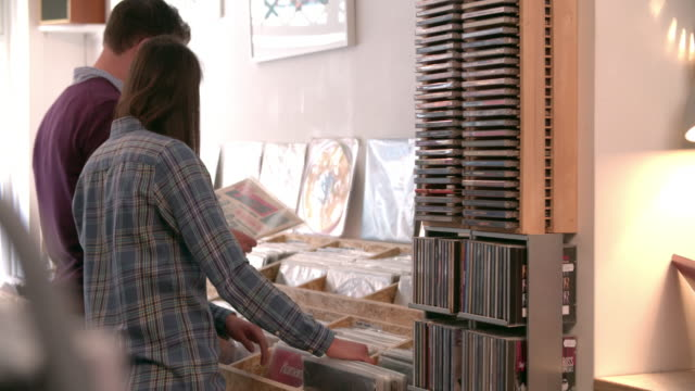 Two-people-browsing-through-records-at-a-record-shop
