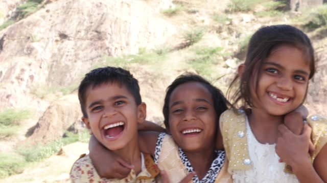 Portrait-of-Indian-kids-friends-siblings-hugging-smiling-playing-and-having-fun