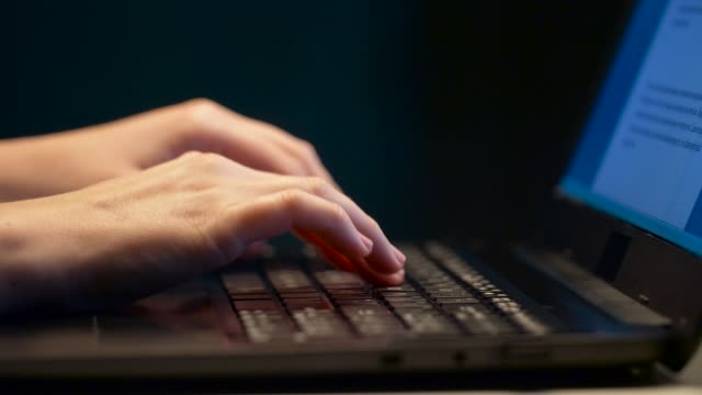 close-up-of-female-hands-with-laptop-typing
