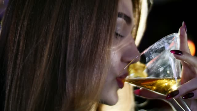Girls-are-in-a-bar-in-the-evening-smoke-a-hookah-drink-cocktails-and-speak-with-each-other-in-slow-motion-in-4k-resolution