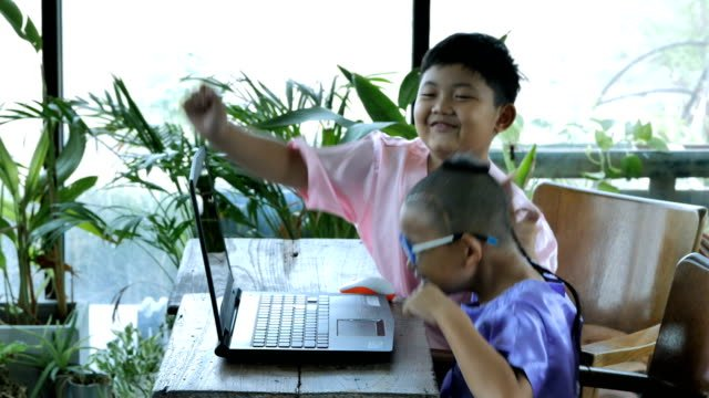 Happy-little-asian-boy-two-people-with-computer-laptop-