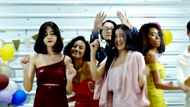Asian-people-having-fun-dancing-at-party-together-People-with-party-celebration-enjoyment-and-new-year-concept-