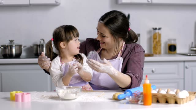 Family-with-special-needs-kid-preparing-bakery