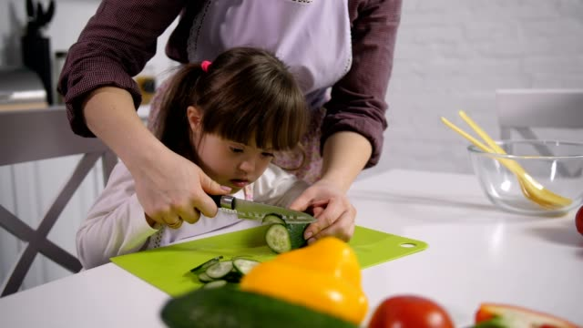Mom-developing-motor-skills-of-down-syndrome-child