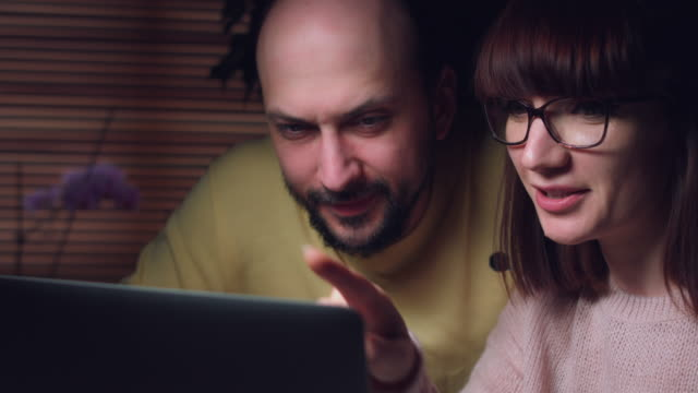 4K-Business-Shot-of-a-Couple-Working-on-Computer-Together-Serious