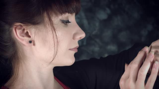4K-Hi-Tech-Shot-of-a-Fitness-Woman-Searching-menu-in-Smartwatch
