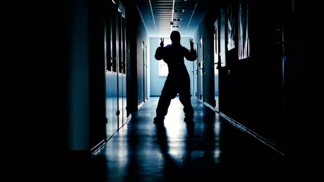 Young-woman-dancing-in-the-corridor-of-the-lab-