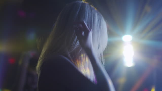 Blond-Girl-is-Dancing-in-Nightclub