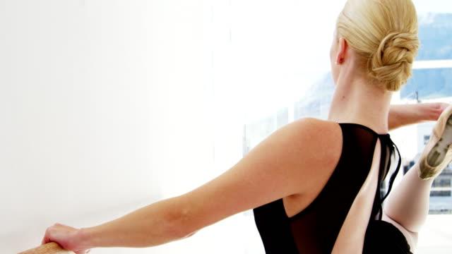 Ballerina-practicing-ballet-dance-at-barre