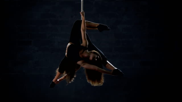 Graceful-girls-performs-a-gymnastic-element-on-the-aerial-hoop