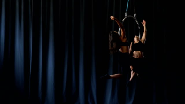 Professional-acrobats-performs-a-gymnastic-trick-on-the-aerial-hoop