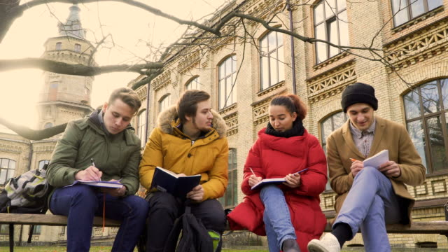 Four-friends-students-discusses-the-exams