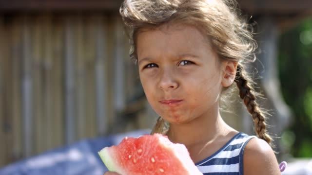 Girl-enjoying-watermelon