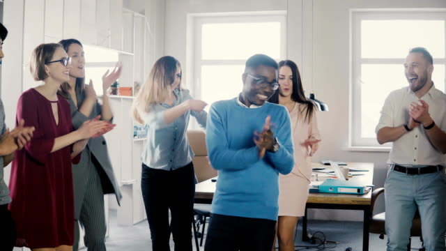 Happy-African-American-businessman-dancing-Casual-man-celebrates-victory-and-achievement-with-mixed-race-colleagues-4K