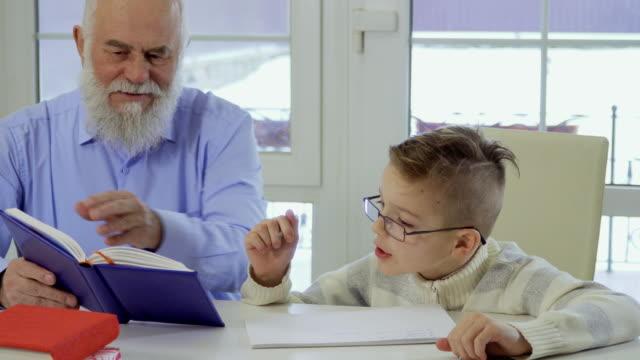 Grandson-asks-grandpa-to-help-him-with-homework