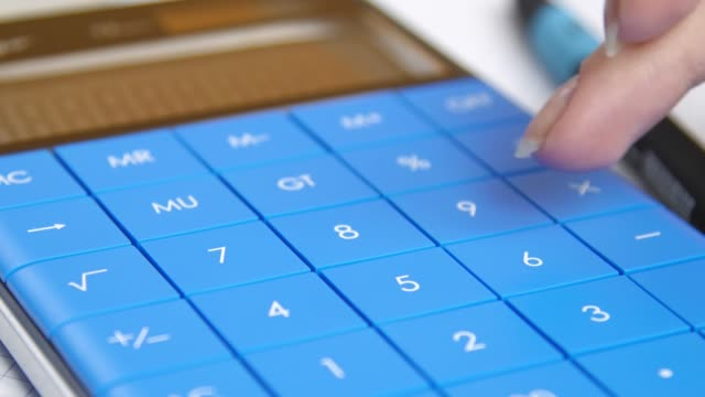 hand-presses-keys-of-the-calculator-calculation-of-profit-or-loss