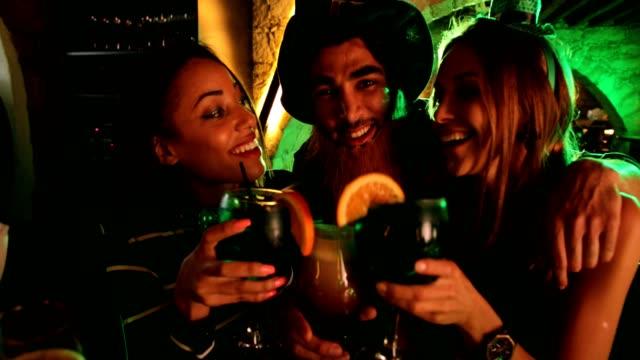 Happy-multi-ethnic-friends-celebrating-Saint-Patrick-s-day-at-Irish-bar