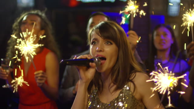 Beautiful-Woman-Dancing-and-Singing-with-Friends