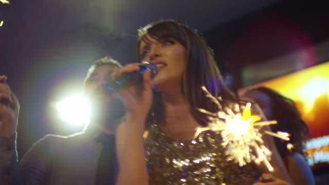 Woman-Singing-Karaoke-with-Sparkler-Firework